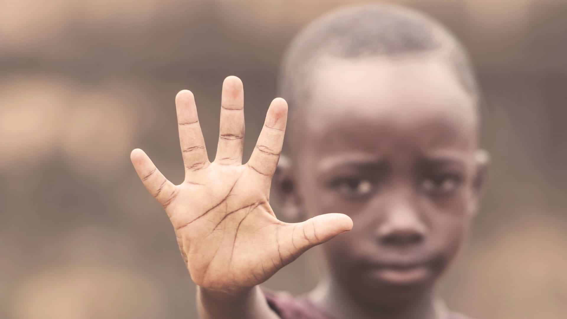 african child holding hand up