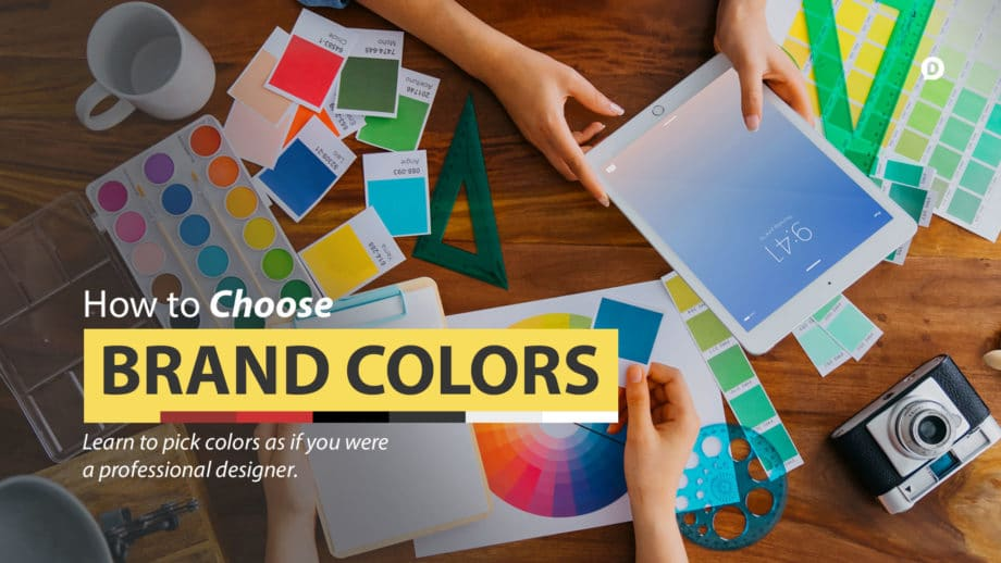 choose brand colors with paint samples all over a desk