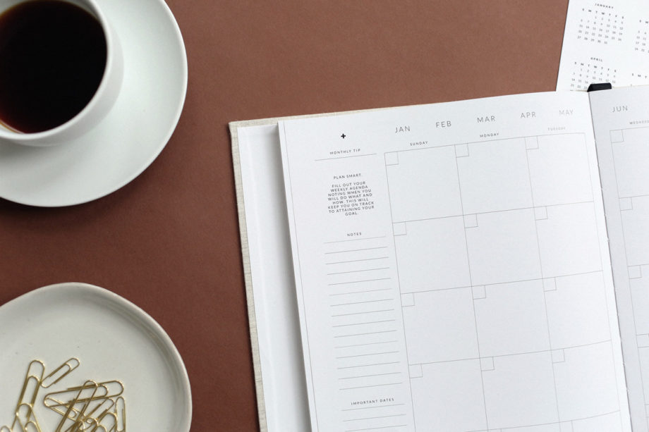 planning calendar on desk with coffee
